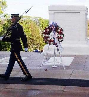 A member of the honor guard paces in front of the Tomb of the Unknown Soldier.