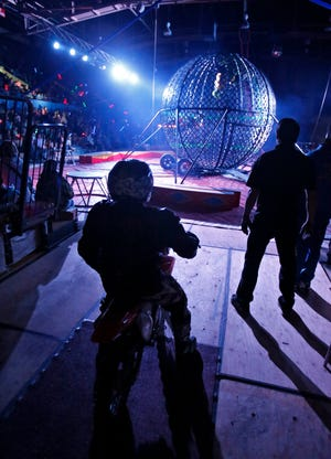 """A circus performer waits in the wings on a motorbike during the Globe of Death""""act at the 2016 Yelduz Shrine Circus in the Aberdeen Civic Arena. The circus is today, Friday and Saturday in Aberdeen."""