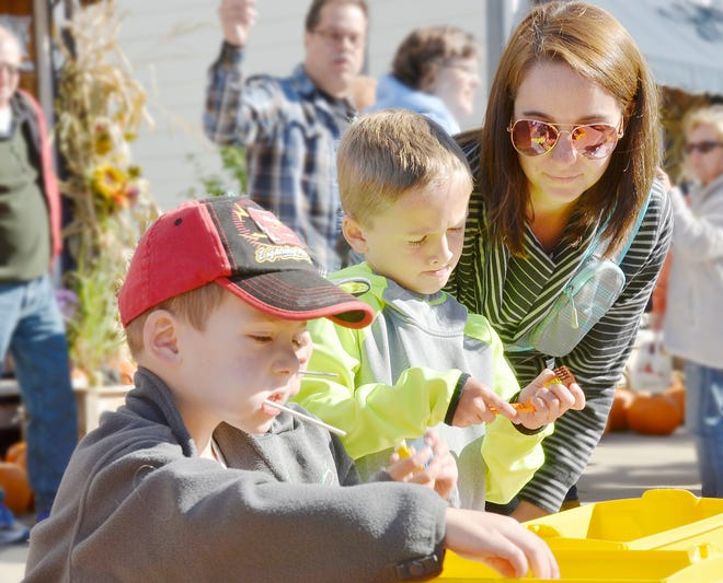 Kids enjoy playing with Legos during a previous Boyne City Harvest Festival. The festival is slated to return to Boyne City on Saturday, Sept. 25 this year.