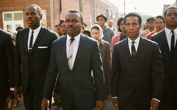 """David Oyelowo, center, as Martin Luther King Jr., leads the historic 1965 civil rights march from Selma to Montgomery, Alabama, in """"Selma."""""""
