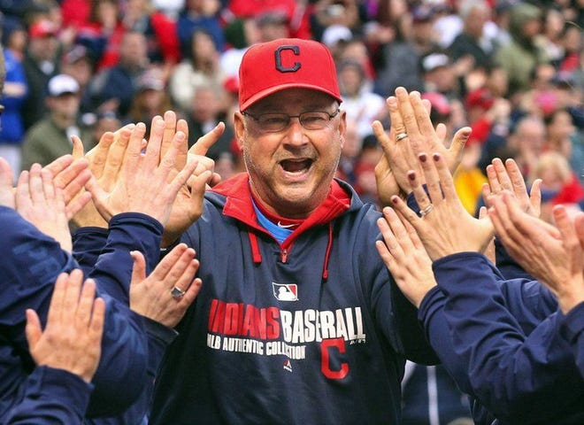 Cleveland Indians manager Terry Francona slaps hands with Progressive Insurance employees during introductions for the Indians home opener against the Minnesota Twins in Cleveland, Friday, April 4, 2014. The Indians defeated the Twins, 7-2. (Phil Masturzo/Akron Beacon Journal/MCT)