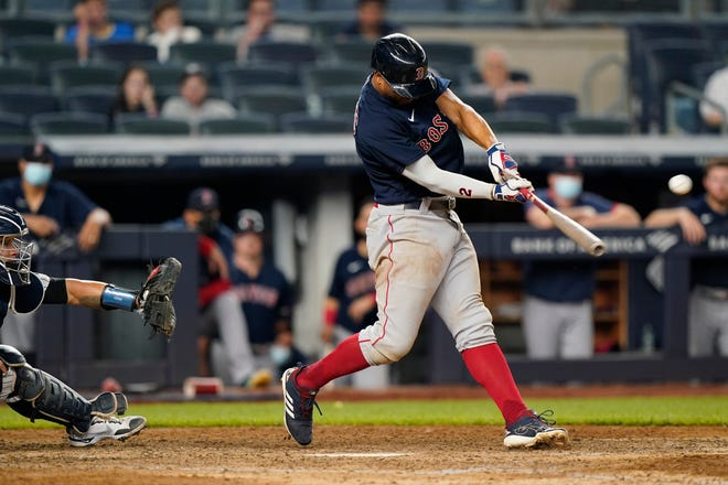 Red Sox shortstop Xander Bogaerts lashes what would be the game-winning two-run single in the 10th inning on Sunday night in the eventual 6-5 victory over the Yankees.