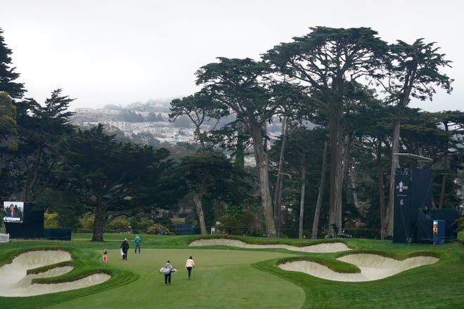 Michelle Wie West, bottom center, walks toward the sixth green during a practice round at the U.S. Women's Open golf tournament in San Francisco, Wednesday, June 2, 2021. (AP Photo/Jeff Chiu)
