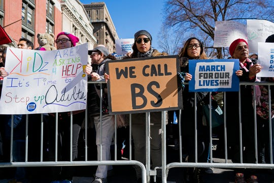 People take part in a march rally against gun violence Saturday in New York. Tens of thousands of people poured into the nation's capital and cities across America on Saturday to march for gun control and ignite political activism among the young.