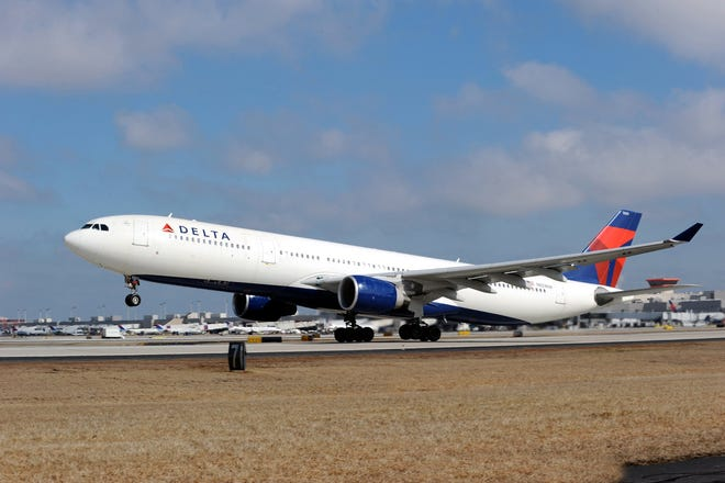 A Delta Air Lines plane is shown landing on a runway in this file photo. A Delta flight from Los Angeles to Atlanta was diverted to Oklahoma City early Saturday after an incident during the flight.