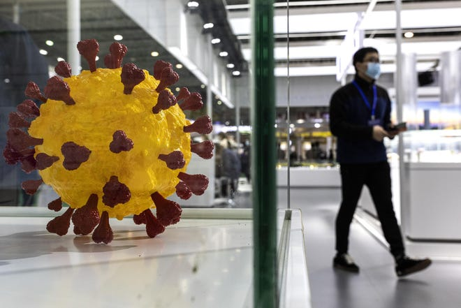 A guest visits the model of coronavirus during the 3rd World Health Expo held on April 8, 2021 in Wuhan, Hubei Province, China. (Getty Images/TNS)