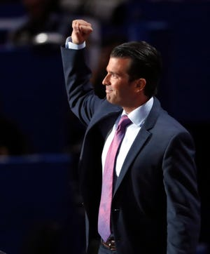 Donald Trump Jr. makes a fist as he leaves the stage after addressing delegates during the Republican National Convention in July 2016 in Cleveland.