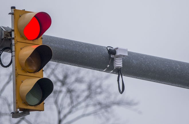 A Road Weather Information System hangs next to a traffic signal at the intersection of Eddy and Cedar streets in South Bend.