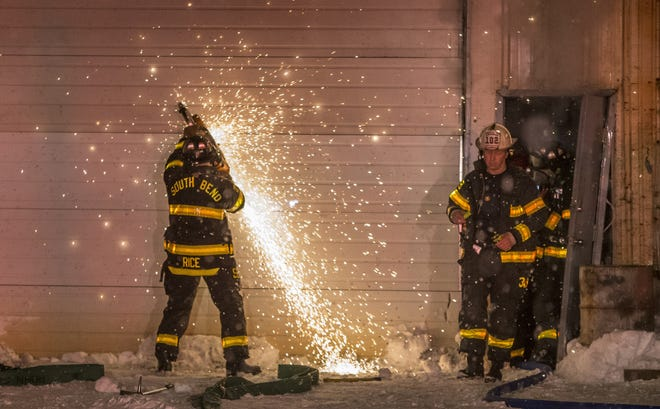South Bend fire crews battle a commercial fire at 1535 S. Main Street, believed to be NAPA Auto Parts and Ridge Paint Warehouse, on Friday, Jan. 31, 2014, in South Bend. Main Street was closed as heavy smoke billowed from the building. SBT Photo/ROBERT FRANKLIN