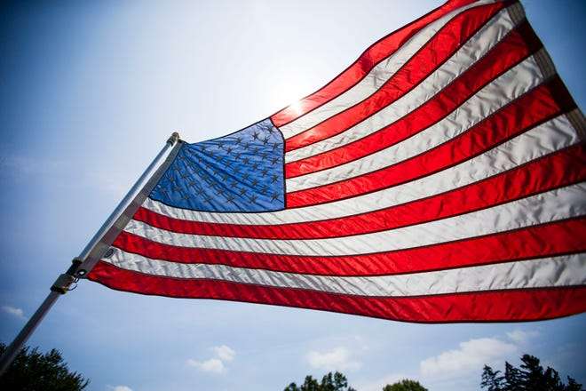 An American flag waves in the wind.