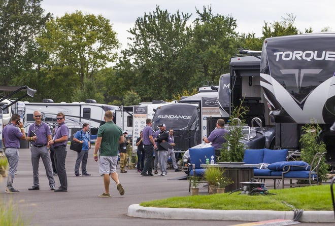 People check out the RVs on display at a pre-pandemic Elkhart RV Dealer Open House. For the second straight year, surging COVID numbers have caused the event to be canceled. Tribune File Photo/MICHAEL CATERINA