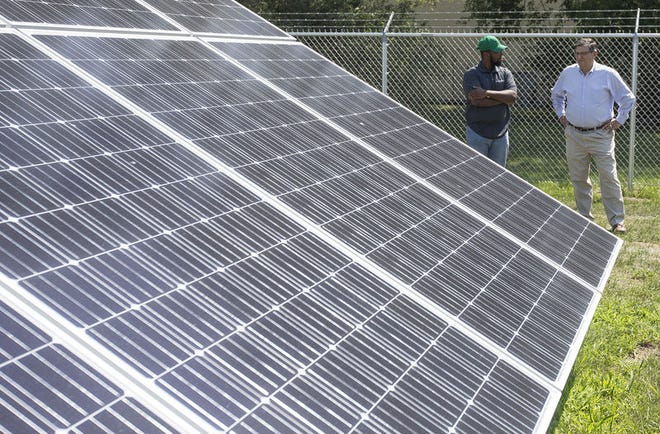 Inovateus Solar installed a solar array, at a Notre Dame warehaouse, that will produce an estimated 196,000 kilowatts of energy per year. It should reduce the amount of energy the building uses per year to operate. Solar energy use is part of a larger Notre Dame plan to reduce its carbon footprint and utilize green energy. Jordan Richardson, Inovateus Solar and Paul A. Kempfe are at right.Tribune Photo/SANTIAGO FLORES