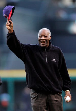 """In this April 14, 2008, file photo, former Cleveland Indians pitcher Jim """"Mudcat"""" Grant waves to the crowd before throwing out the ceremonial pitch before the Indians hosted the Boston Red Sox in a baseball game in Cleveland. Grant, the first Black 20-game winner in the major leagues and a key part of Minnesota's first World Series team in 1965, has died, the Twins announced Saturday, June 12, 2021. He was 85. (AP Photo/Mark Duncan, File)"""