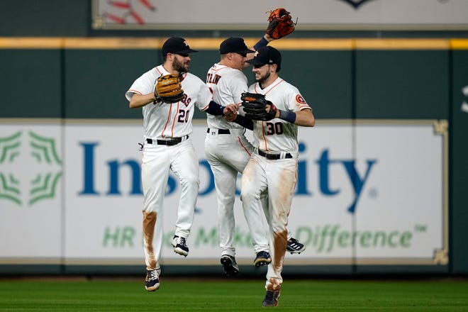 The Astros celebrate their Tuesday victory over the Red Sox.