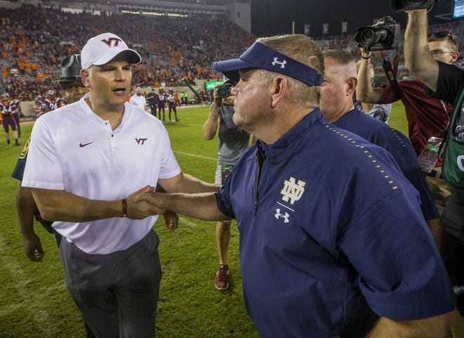 Virginia Tech head coach Justin Fuente, left, shakes hands with Notre Dame head coach Brian Kelly at midfield following Notre Dame's 45-23 win over Virginia Tech in an NCAA college football game on Saturday, October 6, 2018, in Blacksburg, Va. The two team will meet again Saturday night at Lane Stadium.