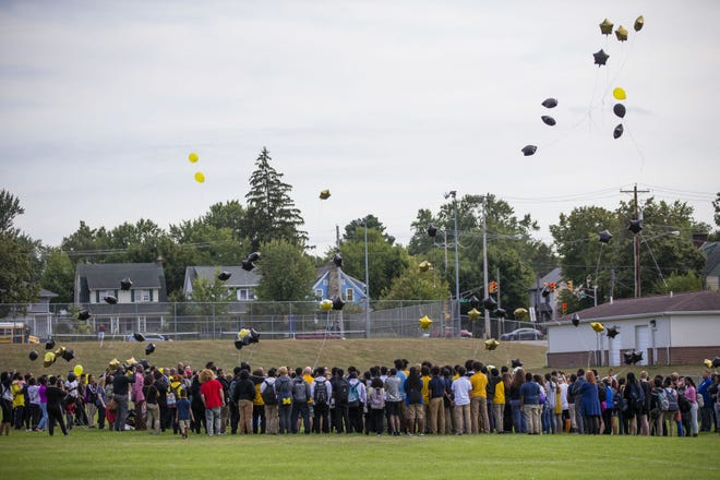 Guests release balloons at a vigil for Curtis Frazier Jr. at Riley High School. The 16-year-old Riley student was shot and killed on Sept. 6, 2019.