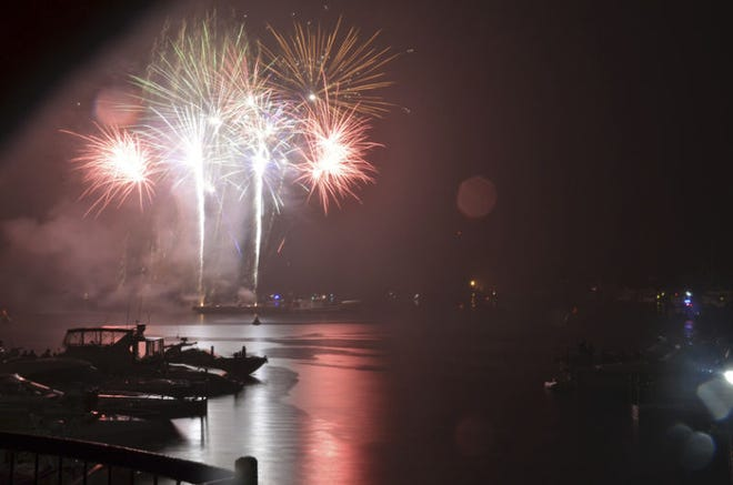FILE PHOTO  A fireworks display is seen during an earlier year's Venetian Festival. This year, festival organizers have added an aerobatic firework and pyrotechnic display to Friday's evening schedule ahead of the fireworks show to be launched from the ground.