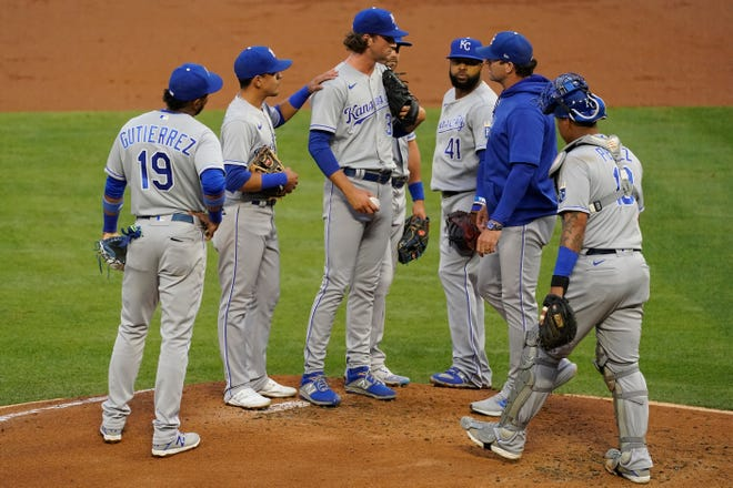 Kansas City Royals starting pitcher Jackson Kowar, center, is taken off the mound during the first inning of a baseball game against the Los Angeles Angels Monday, June 7, 2021, in Los Angeles, Calif. (AP Photo/Ashley Landis)