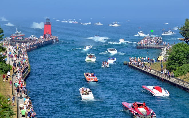 """A roof top view of Charlevoix's Pine River channel as off-shore power boats known as """"Thunder Boats"""" head out into Lake Michigan, Saturday, during the 15th annual Boyne Thunder Poker Run in 2018. The boats make five stops at Lake Michigan destinations picking up cards and the best poker hand wins. The event is a fundraiser for the local Camp Quality and Challenge Mountain non-profit organizations."""