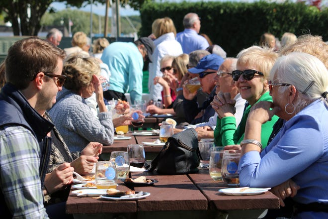 People enjoy food selections from various Harbor Springs area restaurants during a previous Taste of Harbor Springs event in 2019. This year the event is slated for Saturday, Sept. 18. File photo