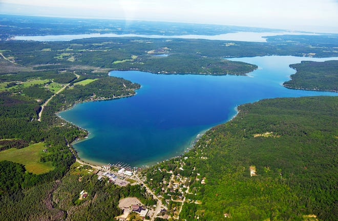 G. Randall Goss/News-Review A view of Walloon Village looking northwest down Walloon Lake. Lake Charlevoix is runs parallel in the upper portion of the photo and Lake Michigan is on the horizon.