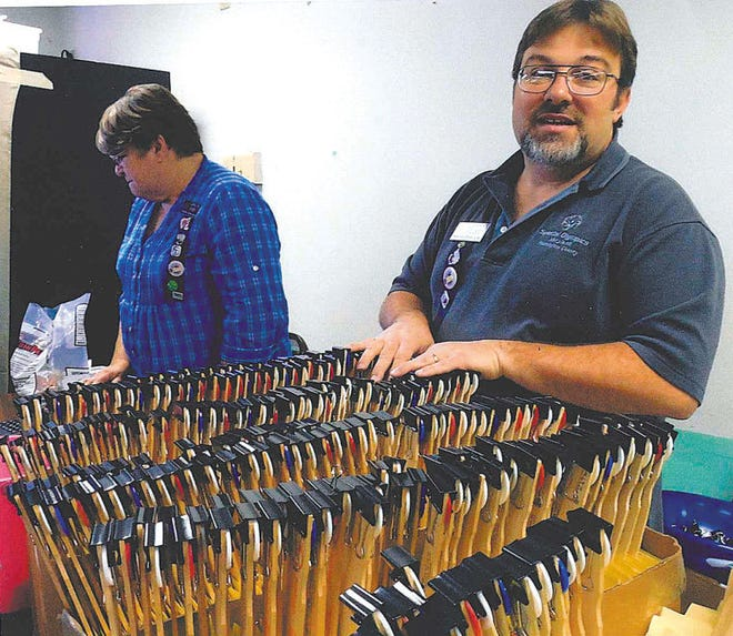Jerry Rowe stood ready with his paddles while Carolyn Roney collected the money at the Tri-State Civitan Club's fall quarter auction held recently at the Funkstown Volunteer Fire Co.