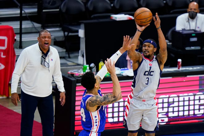 Washington Wizards' Bradley Beal, right, plans to play in Summer Olympics, source says