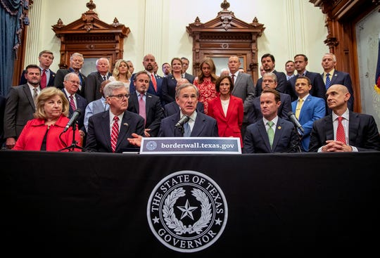 """Gov. Greg Abbott speaks during a press conference on details of his plan for Texas to build a border wall and provide $250 million in state funds as a """"down payment"""" Wednesday in Austin, Texas."""