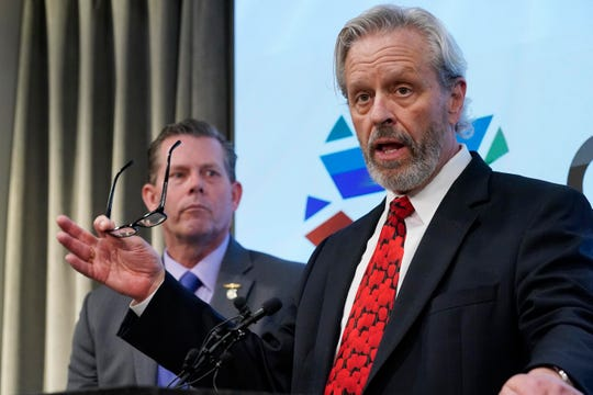 Don Knight, right, attorney for Oklahoma death row inmate Richard Glossip, speaks at a news conference Wednesday in Oklahoma City. State Rep. Kevin McDugle, R-Broken Arrow, is at left.