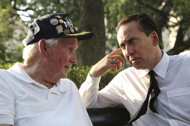 """Flashback: Veteran Richard Stephens, a survivor of the USS Indianapolis sinking in 1945, left, talks with actor Nicolas Cage on the set of """"USS Indianapolis: Men of Courage"""" in Mobile, Ala. Al.com photo/Sharon Steinmann"""