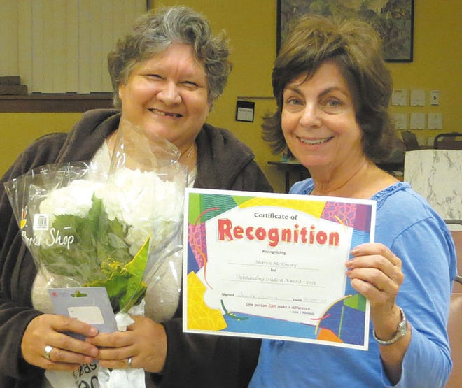 Sharon McKinsey, left,was named student of the year at the annual meeting of the Literacy Council of Washington County. Making the presentation was literacy council tutor Mary Edukat, right.