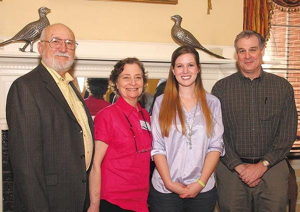 Whitney Clark, third from left, is the winner of the VOWA/Cooperative Living Award, She is shown with, from left, Milan and Marie Majarov, contest co-chairs, and Bill Sherrod, editor of Cooperative Living Magazine.
