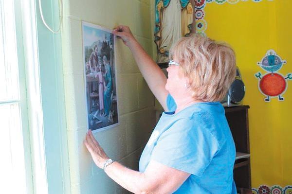 Tina Forsythe, first-grade teacher, is preparing her classroom for Monday's start of school.