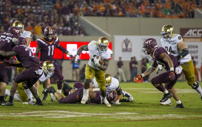 Notre Dame's Dexter Williams (2) breaks away on a touchdown run at Virginia Tech in 2018 in Blacksburg, Va. The two teams meet against Saturday in a game that will be broadcast on ACC Network. Problem is, the network isn't carried by Comcast/Xfinity the major cable provider in the South Bend area.