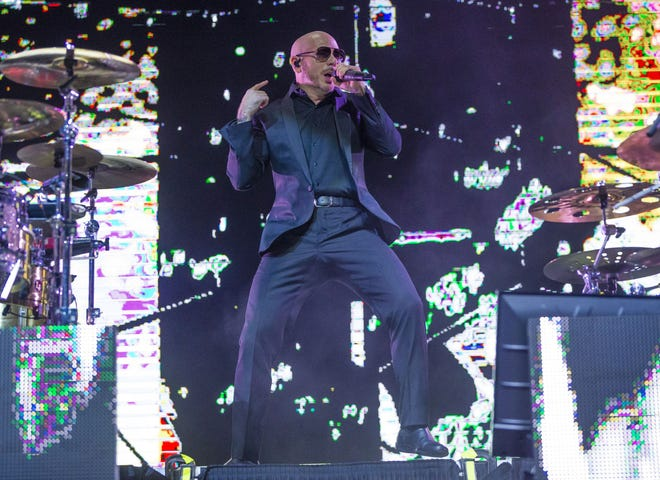 Pitbull, seen here performing in South Bend, Indiana in 2019, will hit the road for his first North American tour in nearly two years in August.