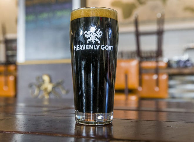 A glass of Niri's Freedom, an imperial stout with honey, dark pitted fruit and coffee notes, is shown at Heavenly Goat Brewing Co. in Granger.