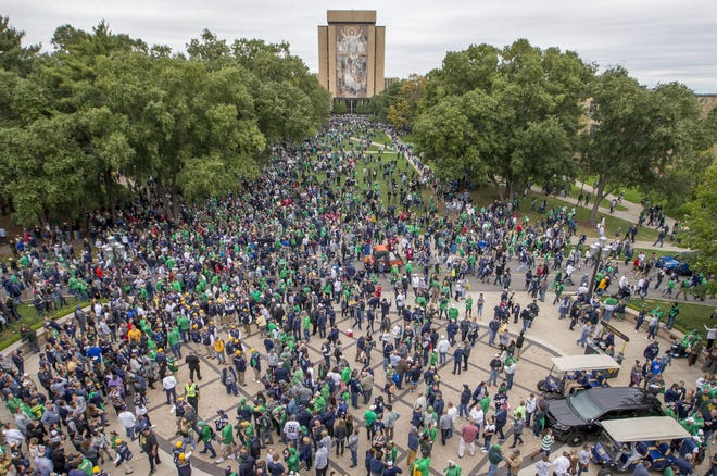 Fans fill the corridor between Notre Dame Stadium and the Hesburgh Library before the Notre Dame-Stanford NCAA college football game on Saturday, Sept. 29, 2018, at Notre Dame Stadium in South Bend.