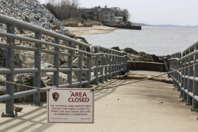 In August 2019, a National Park Service sign closes the walkway to Lakefront Park in Portage, Ind., after a chemical spill at U.S. Steel. The park's waters are again closed after an unknown substance spilled from U.S. Steel on Sunday.  Times of Northwest Indiana Photo, John J. Watkins