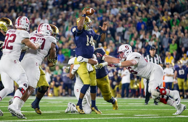 Notre Dame's DeShone Kizer (14) is brought down by Stanford's Harrison Phillips (66) during an NCAA college football game Saturday, October 15, 2016, inside Notre Dame Stadium in South Bend. Tribune Photo/ROBERT FRANKLIN