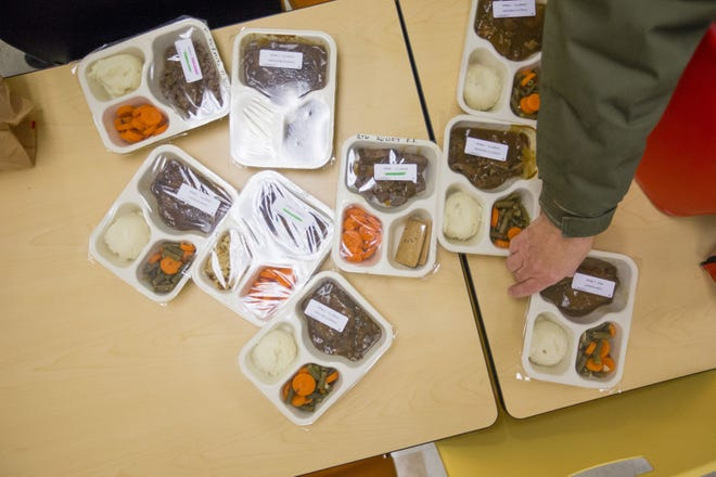 Volunteers at the Meals on Wheels headquarters in South Bend pack up food to be delivered. Real Services is looking for more people to help get the meals to people in need.