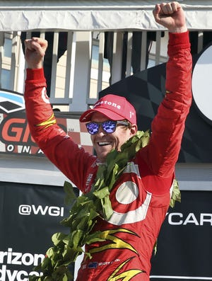 Scott Dixon (9) celebrates in Victory Lane after winning the IndyCar Grand Prix at The Glen auto race Sunday in Watkins Glen, N.Y. Josef Newgarden (21) was second.