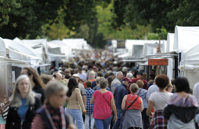 Throngs of visitors fill East Fourth Street during the 2017 Fourth Street Festival of the Arts and Crafts. The annual Bloomington arts fair was first held in 1977. This year, the booths will be farther apart and there will be no live music or spoken word events.