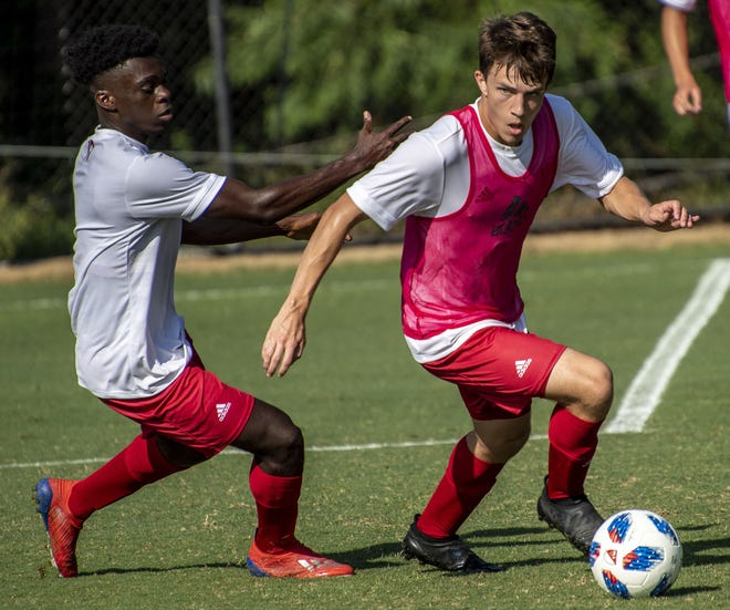 Ben Yeagley moves the ball out of the backfield against Herbert Endeley during Indiana University men's soccer practice Wednesday, August 14, 2019. (Rich Janzaruk / Herald-Times)