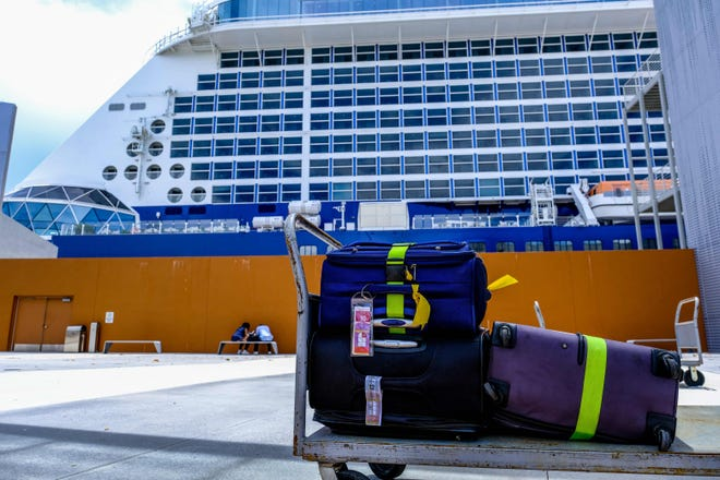 Luggage is ready to roll onto the Celebrity Edge cruise ship in Fort Lauderdale before it departs June 26, the first major cruise ship to restart operations from a U.S. port since the COVID-19 pandemic shut down cruise travel more than 15 months ago.