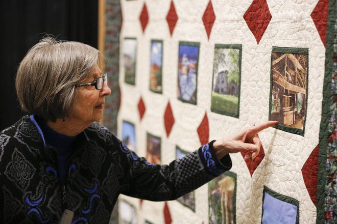 Gayle Cook talks about the quilt made to show the history of real estate properties renovated by Bill and Gayle Cook. Jeremy Hogan | Herald-Times