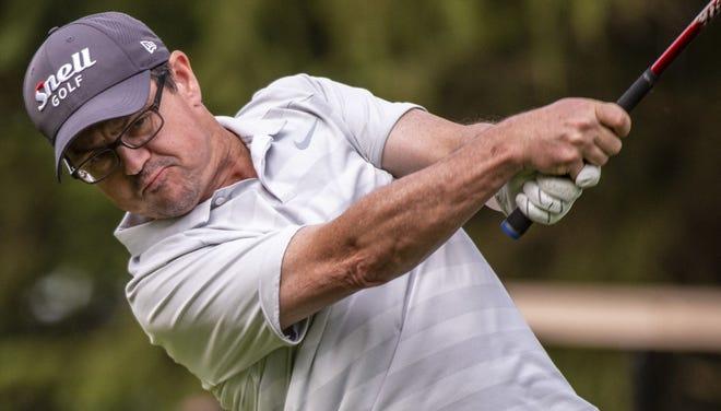 Jim Alexander hitsa tee shot during the 2019 Senior City Golf Tournament at Cascades Golf Course.