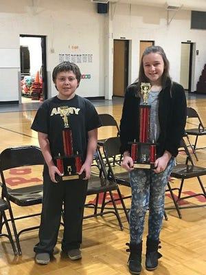 The Patricksburg Elementary School spelling bee runner-up was Devin Beam, left, and the winner was Hailey Rubottom, right.