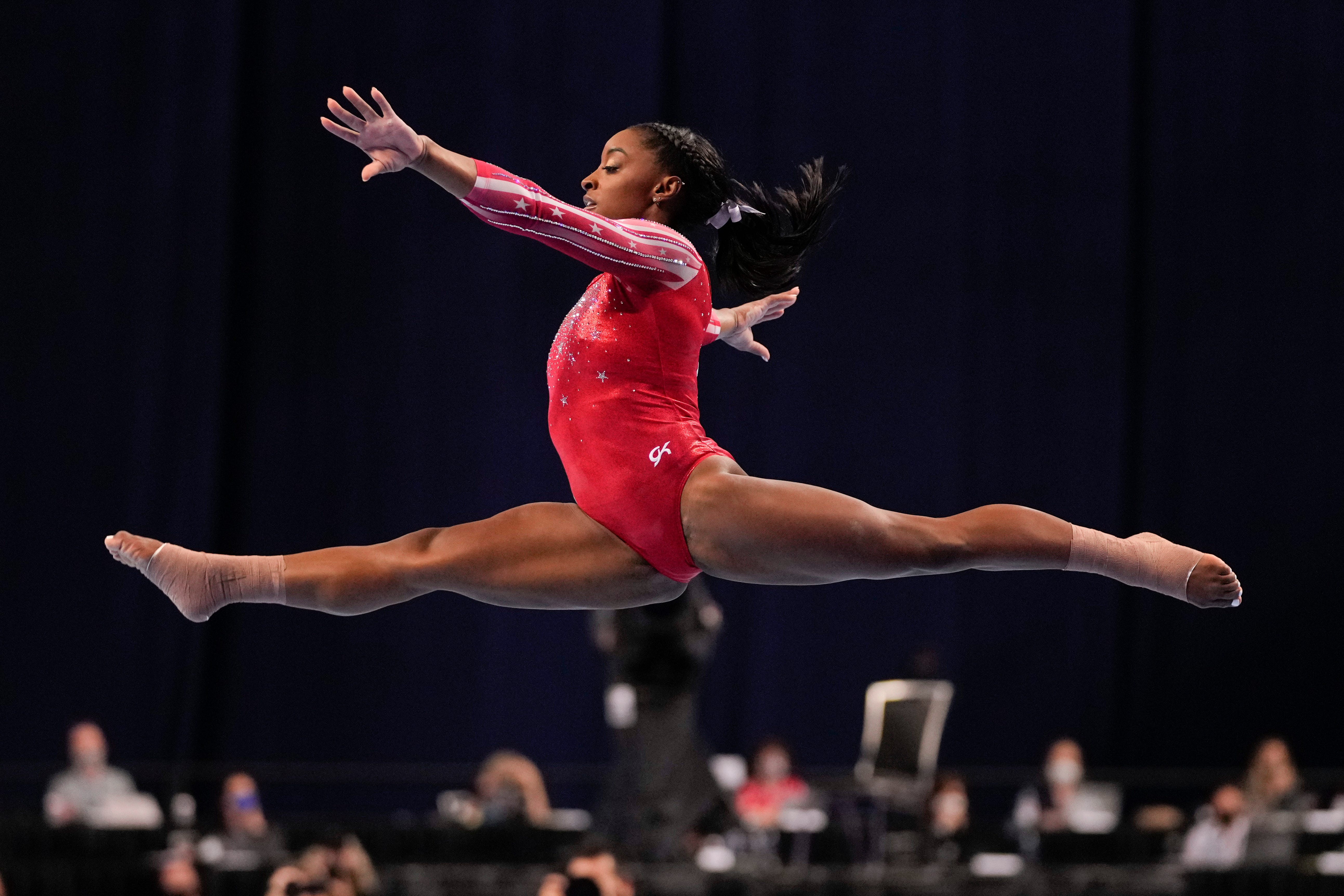 Simone Biles competes in the floor exercise during the women's U.S. Olympic Gymnastics Trials.