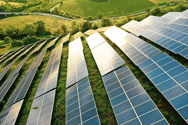 Large solar farm on a hillside.