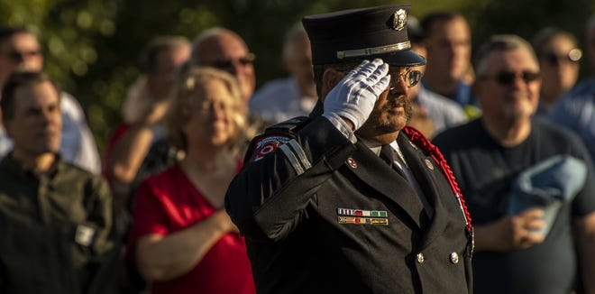 Fire Fighters Union Local 586 member and Honor Guard Cooordinator Robert Loviscek salutes during the September 11th remembrance ceremony at Ivy Tech Community College Wednesday, September 11, 2019. (Rich Janzaruk / Herald-Times)